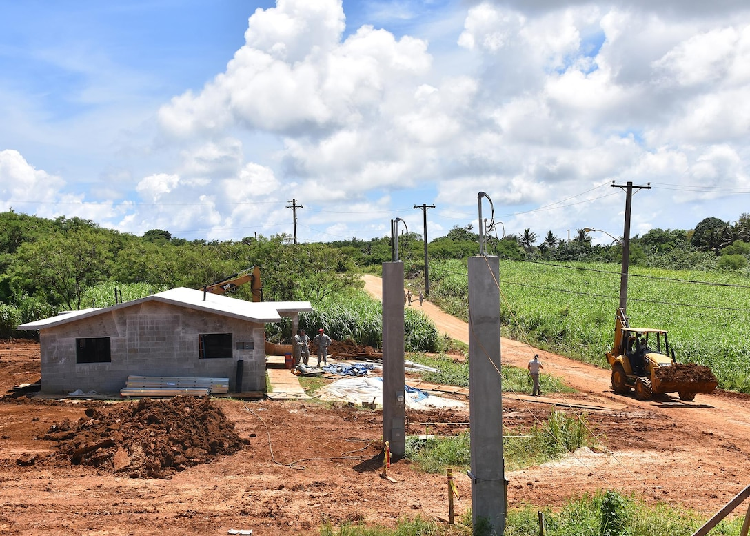 Members from the 143d Civil Engineering Squadron (CES), Rhode Island Air National Guard begin their workday in Inarajan, Guam during an Innovative Readiness Training (IRT) project on September 3, 2016.  The IRT project, in conjunction with Habitat for Humanity Guam is to provide two homes for residents in Inarajan.  The members are part of a 36 Airmen crew from a cross section of trades within the CES.  U.S. Air National Guard photo by Master Sgt. John V. McDonald