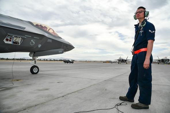Airman 1st Class Nathan Kosters, a 34th Aircraft Maintenance Unit crew chief, prepares to launch an F-35A Lightning II during Red Flag 17-1 at Nellis Air Force Base, Nev., Feb. 7, 2017. (U.S. Air Force photo/R. Nial Bradshaw)