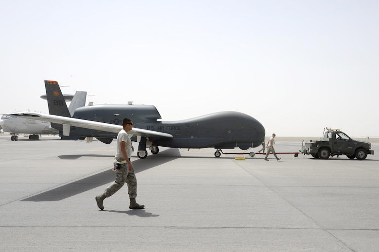 Airmen from an RQ-4B Global Hawk aircraft maintenance unit welcome an RQ-4B after a flight in 2015, in Southwest Asia, in which the aircraft surpassed 10,000 flying hours. When outfitted with communications capabilities, like the Battlefield Airborne Communications Node, a fleet of three redesignated EQ-4B Global Hawks provide clear, precise and reliable communication for Joint and Coalition partners in the Central Command Area of Responsibility. (U.S. Air Force photo/Tech. Sgt. Marie Brown)