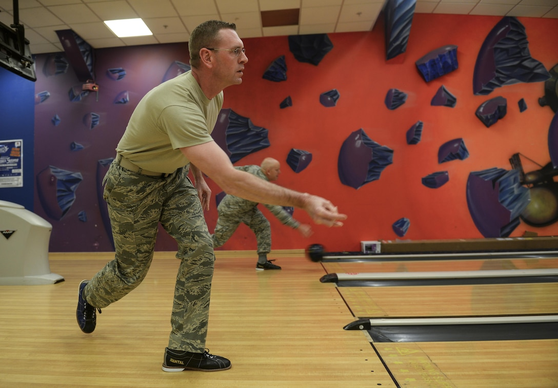 "U.S. Air Force Chief Master Sgt. William Taylor, 100th Civil Engineer Squadron fire chief, bowls during a ""Chiefs vs. Eagles"" game Feb. 7, 2017, on RAF Mildenhall, England. Team Mildenhall leaders played two games of bowling on three lanes. The team with the cumulative highest score from all the lanes and games was deemed the winner. (U.S. Air Force photo by Staff Sgt. Micaiah Anthony)"
