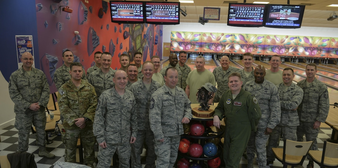 "Team Mildenhall's leaders pose for a photo after a ""Chiefs vs. Eagles"" game Feb. 7, 2017, on RAF Mildenhall, England. After two games of bowling on three lanes the final total score was Chiefs: 878 to the Eagles: 762. (U.S. Air Force photo by Staff Sgt. Micaiah Anthony)"