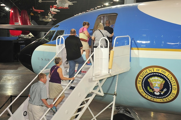 DAYTON, Ohio -- Museum visitors walk up the steps to board the Boeing VC-137C SAM 26000 which is on display in the Presidential Gallery at the National Museum of the United States Air Force. (U.S. Air Force photo by Ken LaRock)