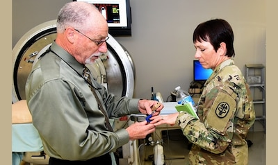 U.S. Army Institute of Surgical Research senior scientist Dr. Victor Convertino, right, demonstrates the functions and capabilities of the Compensatory Reserve Index to Army Maj. Gen. Barbara Holcomb, commanding general, U.S. Army Medical Research and Material Command. Army photo by Steven Galvan
