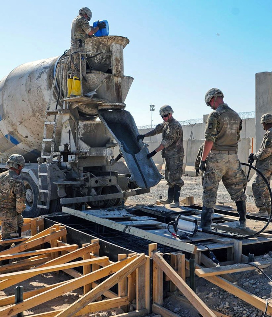 Horizontal construction engineers assigned to the 368th Engineer Battalion of the U.S. Army Reserve use a cement truck to build a concrete slab in Afghanistan. The battalion is assigned to the 176th Engineer Brigade (Task Force Chaos). Task Force Chaos is responsible for mission command and control of more than 1,600 Active Duty, National Guard and Army Reserve engineer forces across the U.S. Central Command area of responsibility while deployed. (U.S. Army photo courtesy photo/released)