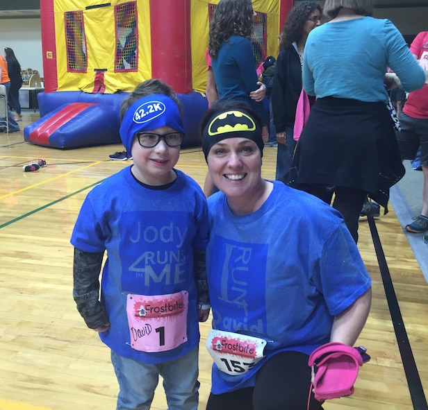 Jody Moll (right), spouse of Air Force Research Laboratory High Speed Experimentation Branch Deputy Chief Maj. Jason Moll, shares a moment with her buddy David whom she sponsored during the 24th Annual Frostbite 5k, 10k and 1-Mile Fun Run/Walk Marathon Feb. 2016 in Fletcher, North Carolina. The sponsorship was through the I Run 4 program. Jody was nominated recently for the 2017 Joan Orr Air Force Spouse of the Year Award. (Courtesy photo)