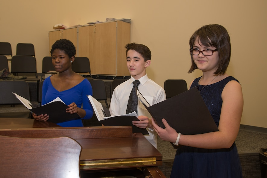 Hanscom Middle School students, Saeeda Frimpong, left, Miles Fortune, center, and Heather Anderson practice music selections at the middle school Feb. 8. The students were selected to perform at the Massachusetts Music Educators Association Eastern District Junior Festival scheduled March 3 and 4 at nearby Lincoln-Sudbury Regional High School. Anderson will sing in Treble Choir and Frimpong and Fortune will sing with the Mixed Choir. (U.S. Air Force photo by Mark Herlihy)