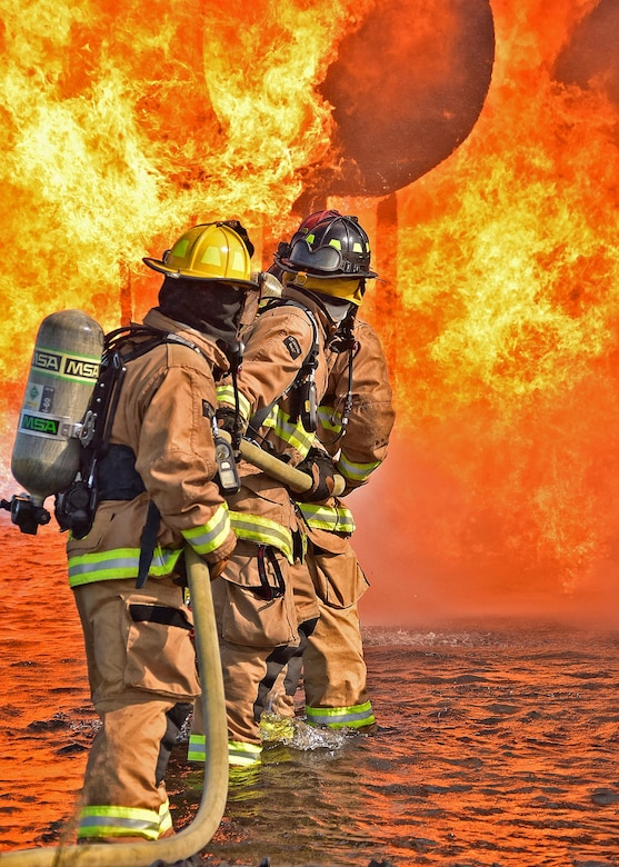 Military and Civilian members of the Quonset Fire Department from the 143d Airlift Wing, Rhode Island Air National Guard conduct live fire training at Westover Air Reserve Base, Chicopee, Massachusetts, September 29, 2016. The live fire training is part of annual qualification requirements and allows military and civilians to train in collaboration. US Air National Guard Photo by Master Sgt Janeen Miller