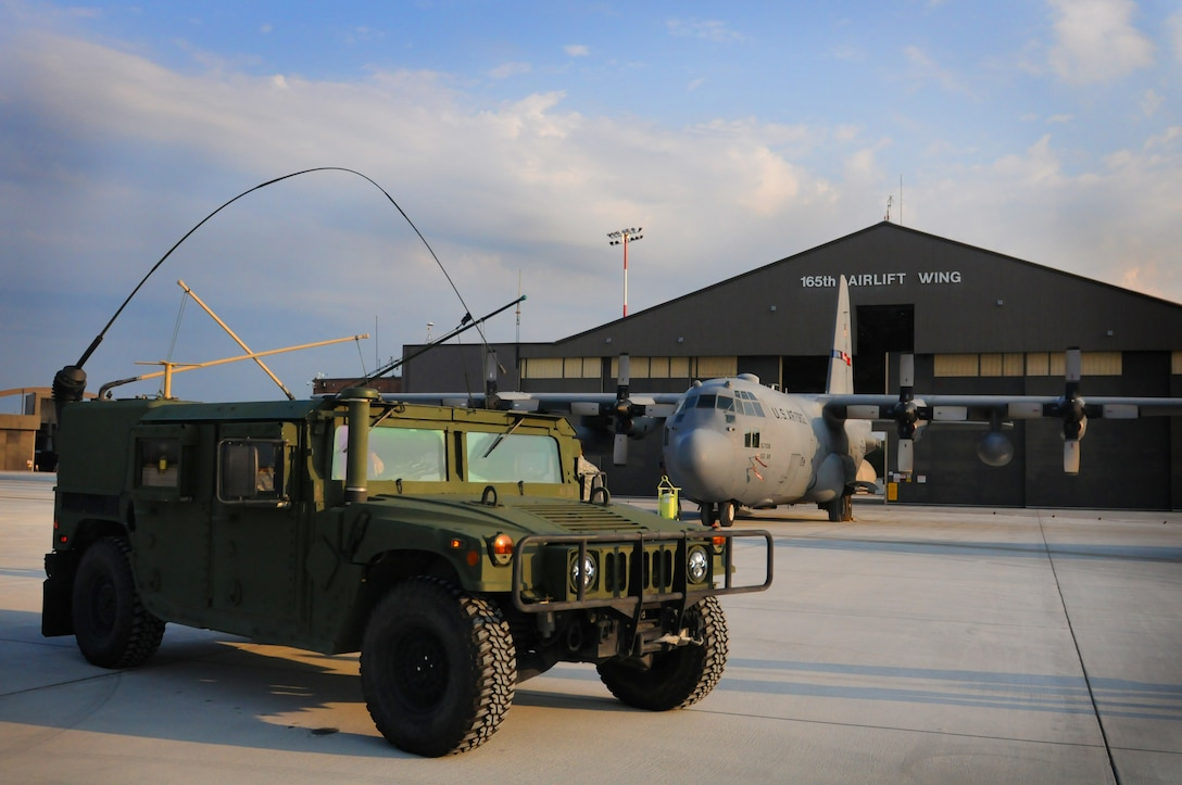 A 165th Airlift Wing Air Support Operations Squadron humvee sits on the flight line in front of a C-130H3 Hercules at the 165th AW, Savannah, Ga. September 11, 2016. (U.S. Air National Guard photo by Tech. Sgt. Amber Williams)