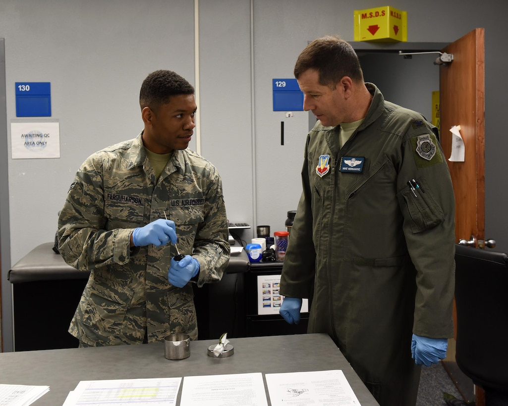 U.S. Air Force Airman 1st Class Donvin Farquharson, 325th Operations Support Group aircrew flight equipment technician, teaches Col. Michael Hernandez, 325th Fighter Wing commander, how to properly inspect and maintain aircrew flight equipment at Tyndall Air Force Base, Fla., Feb. 1, 2017. Farquharson was chosen to be shadowed by the base commander as a way for the commander to get in touch with Airmen and understand their daily jobs and the challenges they may face. (U.S. Air Force photo by Airman 1st Class Cody R. Miller/Released)
