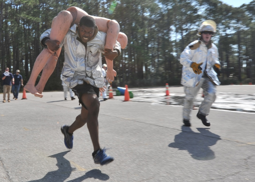 U.S. Air Force Staff Sgt. Antonio Johnson, 325th Security Forces Squadron S-4 mobility NCOIC, carries a training dummy during the Combat Challenge Comprehensive Airman Fitness day on Feb. 3, 2017. Airmen from various different squadrons and members from the Rutherford High School Junior Reserve Officer Training Corps competed in the event which tested their strength, stamina and teamwork skills. (U.S. Air Force photo by Senior Airman Ty-Rico Lea/Released)