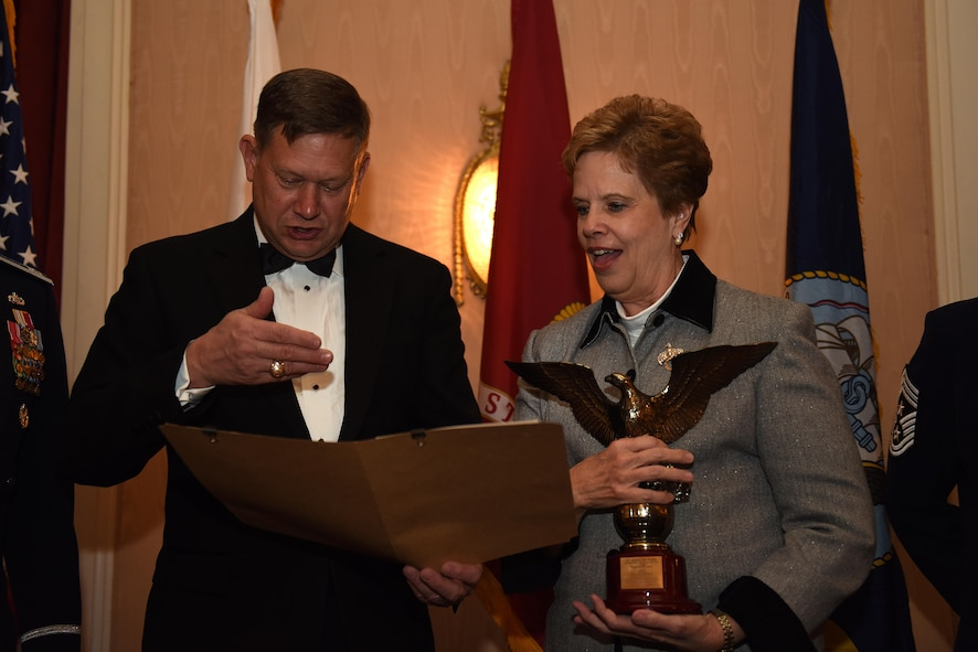George Gagnon, Air Education and Training Command International Training and Education director, reads the award information for the Dr. Carol Bonds' International Student Support Award at the Goodfellow Air Force Base Annual Awards in the Cactus Hotel in San Angelo, Texas, Feb. 3, 2017. This award is presented to a person whose long-term volunteer efforts have significantly and positively helped international students at AETC schools adjust to life in the U.S. and succeed in their academic endeavors. (U.S. Air Force photo by Airman 1st Class Caelynn Ferguson/Released)