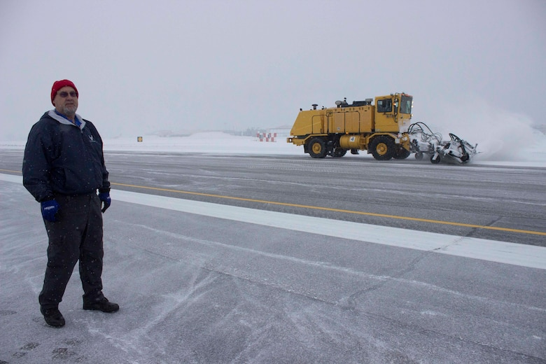 Preston Benedyk, vehicle and snow control manager at the Air Force Civil Engineer Center, evaluates snow removal methods being used at Hill Air Force Base, Utah, during a recent consulting visit. During normal operations, snow brooms clear 50-foot swaths of snow, working from the center of the runway to each edge. (U.S. Air Force Photo/Susan Lawson)