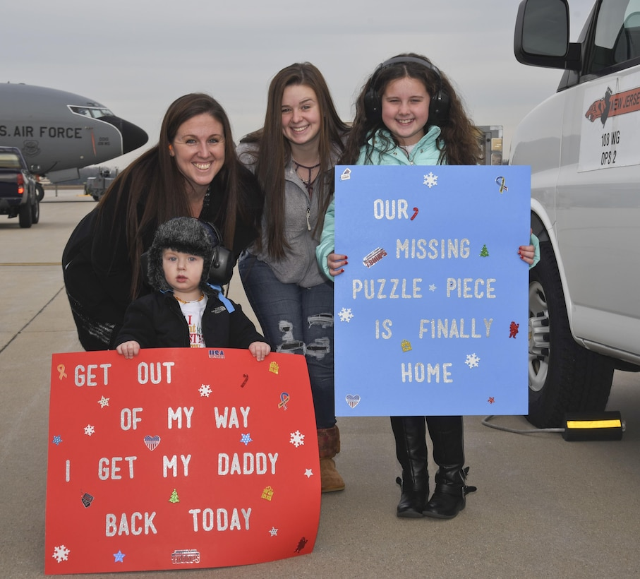 The Balas family has their signs ready at Joint Base McGuire-Dix-Lakehurst, N.J., Dec. 21, 2016, for the return SSgt Jason Balas an 108th Wing Crew Chief, from his deployment. SSgt Balas and 25 other 108th Airmen returned home after supporting operation Inherent Resolve. (U.S. Air National Guard photo by Staff Sgt. Ross A. Whitley/Released)