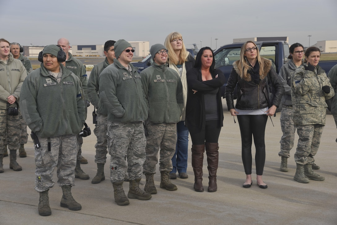 Families and friends of deployed Airmen wait for the KC-135R door to open on the flight line at Joint Base McGuire-Dix-Lakehurst, N.J., Dec. 21, 2016. 26 New Jersey Air National Guard Airmen from the 108th Wing returned home after supporting operation Inherent Resolve. (U.S. Air National Guard photo by Staff Sgt. Ross A. Whitley/Released)
