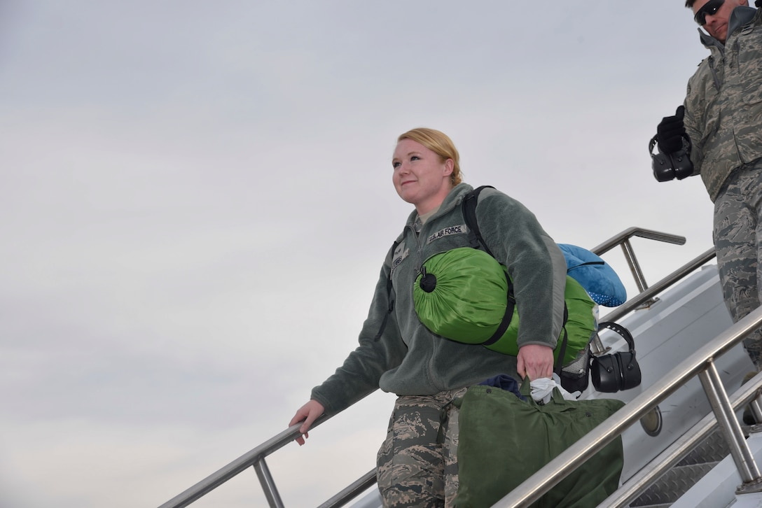 Senior Airmen Rachel Stubbs, Fuel Systems Apprentice from the 108th Wing, New Jersey Air National Guard, searches the crowd for familiar faces at Joint Base McGuire-Dix-Lakehurst, N.J., Dec. 21, 2016, as she returns from supporting operation inherent resolve. (U.S. Air National Guard photo by Staff Sgt. Ross A. Whitley/Released)