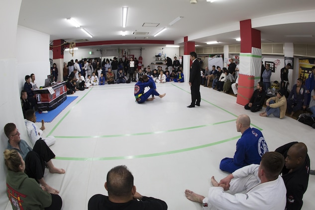 U.S. Marines form Marine Corps Air Station Iwakuni watch Japanese locals compete during the Duamau Tournament, a jiu jitsu competition at the TK Training Center in Hiroshima, Japan, Feb. 5, 2017.  Jiu jitsu is an art of weaponless fighting which employs holds and throws to subdue or disable an opponent. The Marines displayed their hard work and dedication through competition in their respective weight classes against Japanese locals. (U.S. Marine Corps photo by Lance Cpl. Joseph Abrego)