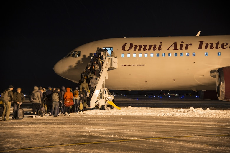 U.S. Air Force Airmen board an aircraft at Misawa Air Base, Japan, Feb. 7, 2017. The Airmen departed to Andersen Air Force Base, Guam, as part of exercise COPE NORTH 17. 