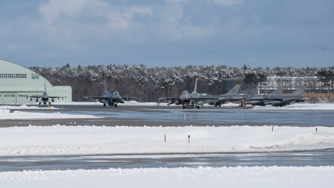 Three F-16 Fighting Falcons taxi on the runway at Misawa Air Base, Japan, Feb. 7, 2017. Airmen from the 14th Fighter Squadron departed to Andersen Air Force Base, Guam, as part of exercise COPE NORTH 17. The annual exercise serves as a keystone event promoting stability and security throughout the Indo-Asia-Pacific region by enabling regional forces to hone vital readiness skills critical to maintaining regional stability. (U.S. Air Force photo by Airman 1st Class Sadie Colbert)