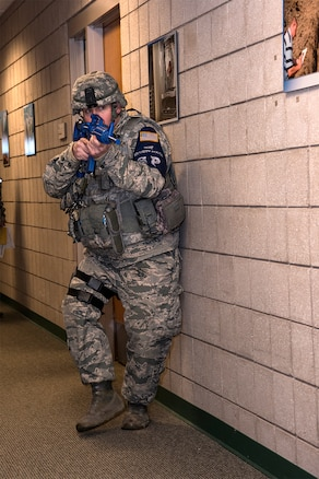 170207-Z-MI929-019 - U.S. Air Force Staff Sgt. Jeffry Declercq, Security Forces specialist at the 127th Wing Selfridge Air National Guard Base, Michigan, searches a building for suspects and victims on base during an active shooter exercise on Feb. 7, 2017. The 127th Wing performed an active shooter response exercise to prepare Airmen to survive an incident on base or in their civilian lives. (Michigan Air National Guard photo by Terry L. Atwell/released)
