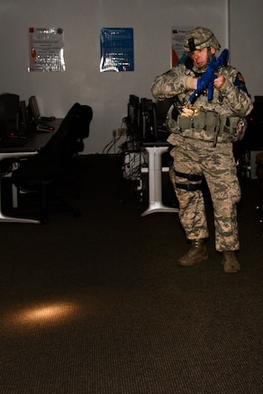 170207-Z-MI929-022 - U.S. Air Force Staff Sgt. Jeffry Declercq, Security Forces specialist for the 127th Wing at Selfridge Air National Guard Base, Michigan, searches a building for suspects and victims during an active shooter exercise on Feb. 7, 2017. The 127th Wing performs exercises like this one to prepare airmen and civilian employees to survive an incident on base or in their civilian lives. (Michigan Air National Guard photo by Terry L. Atwell/released)