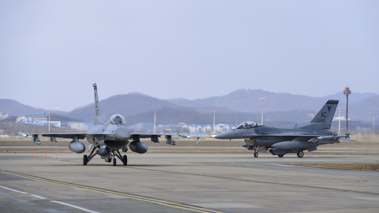 Two F-16 Fighting Falcons assigned to the 119th Fighter Squadron from the New Jersey Air National Guard taxi off of the runway at Osan Air Base, Republic of Korea, Feb. 9, 2017. Members of the 177th Fighter Wing deployed to Osan as part of a Theater Security Package to help bolster the strength of allied air forces on the Korea peninsula. (U.S. Air Force photo by Staff Sgt. Victor J. Caputo)