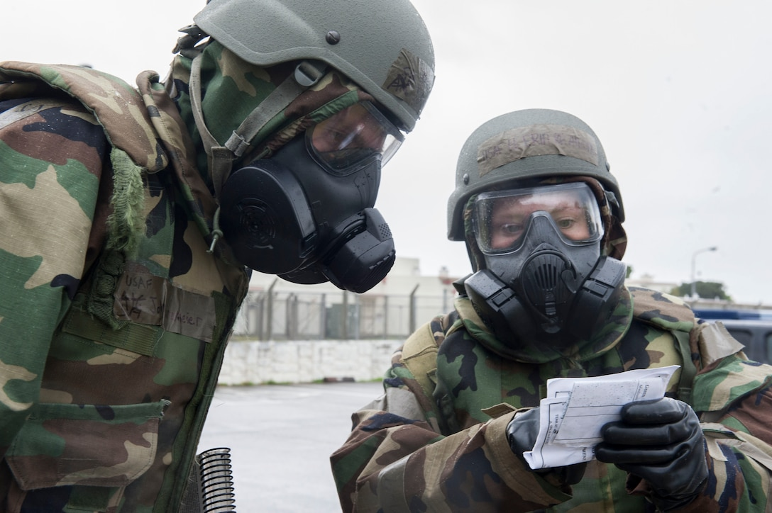U.S. Air Force Airmen from Kadena Air Base, Japan, examine a post-attack reconnaissance stand during Exercise Green Dragon Feb. 9, 2017. Simulated conventional and chemical attack situations occurred during the exercise, testing Kadena's readiness for such situations. (U.S. Air Force photo by Senior Airman Lynette M. Rolen/Released)