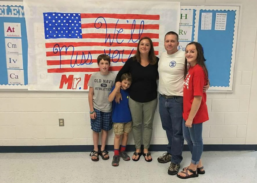 Master Sgt. Jason Paseur, the 386th Air Expeditionary Wing historian, poses for a photo with his family at Trion High School in northwest Georgia. He is a reservist at Dobbins Air Reserve Base, Ga. and teaches history as a civilian. (Courtesy photo)