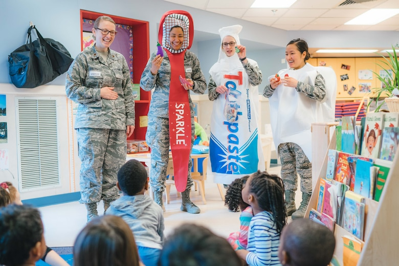 Members of the 779th Dental Squadron show examples of healthy foods to children at the Child Development Center at Joint Base Andrews, Md., Feb. 3, 2017. As part of National Children's Dental Health Month, 779th DS Airmen spoke with children about brushing, flossing and eating healthy snacks. (U.S. Air Force photo by Senior Airman Delano Scott)