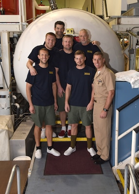 NAVAL SUPPORT ACTIVITY PANAMA CITY Fla. (February 2, 2017) - Sailors at the Navy Experimental Diving Unit (NEDU) stand next to Cmdr. Jay Young, commanding officer of NEDU (right), after emerging from the Ocean Simulation Facility (OSF).  The Sailors coming out of the OSF had just finished the first 500 ft. saturation dive in over 10 years.