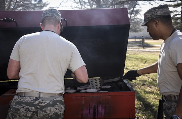 70th Intelligence, Surveillance and Reconnaissance Wing First Sergeant Council grills hamburgers and hot dogs for the Sexual Assault Prevention and Response Office ribbon cutting, Feb. 6, 2017 at Fort George G. Meade, Md. (U.S. Air Force photo/Staff Sgt. AJ Hyatt)