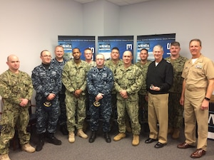 """170208-N-BK152-016 Vice Adm. Thomas Moore, commander, Naval Sea Systems Command, visits with service members at Naval Surface Warfare Center, Crane Division (NSWC Crane), on Feb. 8, 2017. Moore's visit to NSWC Crane was focused on learning more about the technical capabilities that reside in southern Indiana and to discuss how Crane's efforts contribute to his """"Expand the Advantage"""" campaign for NAVSEA. (U.S. Navy photo by NSWC Crane/Released)"""