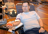 U.S. Air Force Tech. Sgt. Dallas Allen, 488th Intelligence Squadron cryptologic language analyst, donates blood at the Armed Services Blood Program blood drive Feb. 7, 2017, on RAF Mildenhall, England. Throughout the day, military members, civilians, retirees and family members age 17 and older, donated blood which will be taken to Landstuhl Regional Medical Center, Germany. From there, the blood will be used to support missions in European Command, Central Command and Africa Command, as well as in military treatment facilities. (U.S. Air Force photo by Karen Abeyasekere)