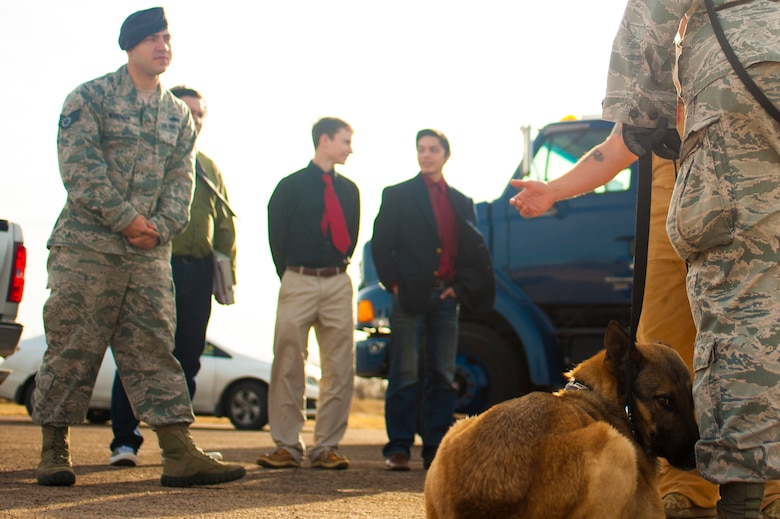 U.S. Air Force Staff Sgt. Tyler Wiseman, 17th Security Forces Squadron K9 handler, prepares students from Ballinger High school for a dog search demonstration at Goodfellow Air Force Base, Texas, Feb. 8, 2017. The students visited Goodfellow Air Force Base to help their decision to join the military. (U.S. Air Force photo by Senior Airman Scott Jackson/Released)