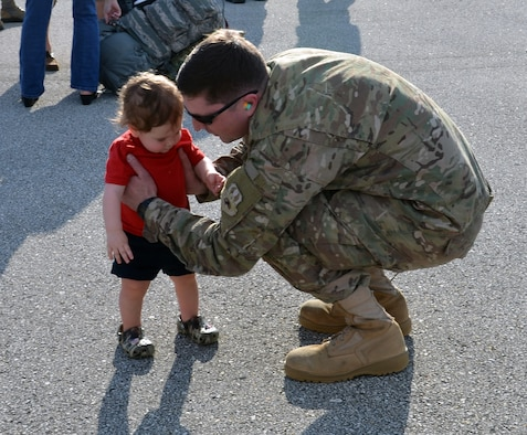 Staff Sgt. Gordon Grooms, a reservist from the 920th Aircraft Maintenance Squadron, greets his son at Patrick Air Force Base, Fla., upon return from a four-month deployment Feb. 8, 2017. Approximately 50 wing reservists were welcomed home by friends, family members and fellow Airmen on the Patrick AFB flight line. (U.S. Air Force photo by 1st Lt. Anna-Marie Wyant)