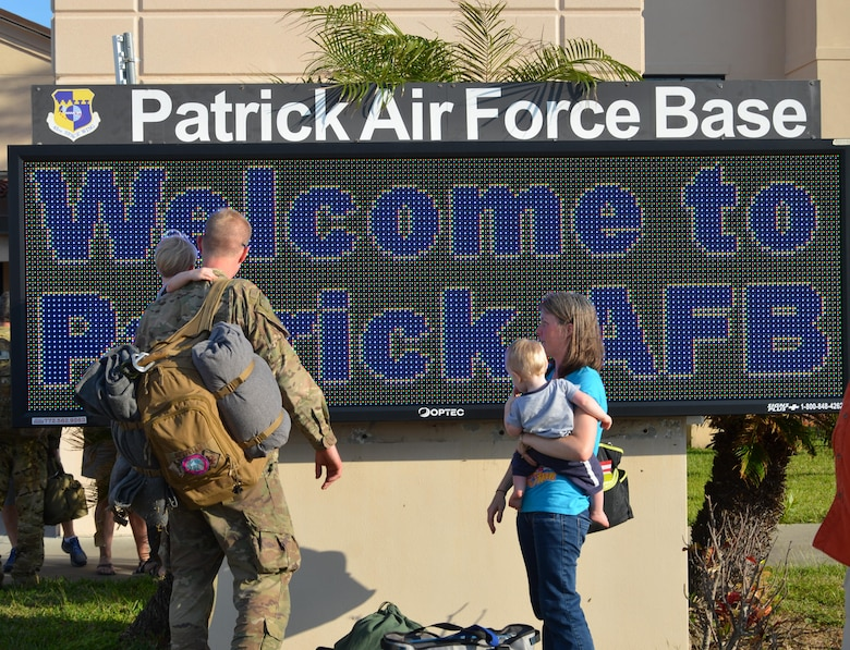 Air Force reservists greet their friends and family on the flight line at Patrick Air Force Base, Fla., upon return from a four-month deployment Feb. 8, 2017. Approximately 50 wing reservists returned from Afghanistan and were transported to Patrick by an Air Force C-17 Globemaster aircraft. (U.S. Air Force photo by 1st Lt. Anna-Marie Wyant)