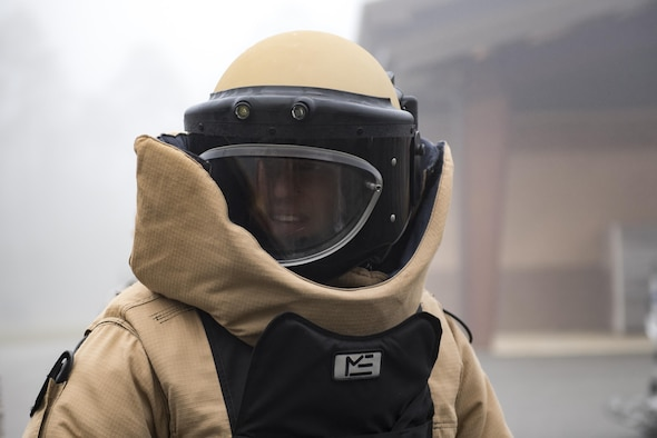Capt. David Melear, 23d Wing assistant staff judge advocate, dons an Explosive Ordnance Disposal suit during an Emerge Moody course, Feb. 2, 2017, at Moody Air Force Base, Ga. The bomb suit provides EOD technicians protection against fragmentation, impact and heat while handling explosives. (U.S. Air Force photo by Airman 1st Class Daniel Snider)