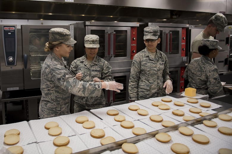 Airman 1st Class Ardella Ring, 23d Force Support Squadron food service apprentice, shows 2nd Lt. Esther Shim and Senior Airman Alyssa Lemy, both students of Emerge Moody, the food preparation process at the Georgia Pines Dining Facility, Feb. 2, 2017, at Moody Air Force Base, Ga. This was the fifth time the members of Emerge Moody met to tour Moody's facilities. (U.S. Air Force photo by Airman 1st Class Daniel Snider)