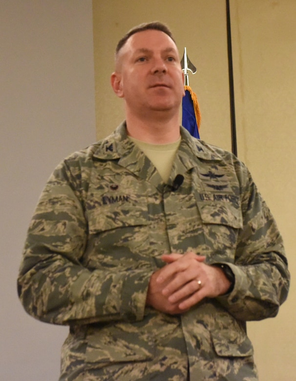 Col. Robert Lyman, 628th Air Base Wing commander, addresses Airmen during a commander's call at the Charleston Club Feb 3, 2017. The commander's call covered plans for the dining facility, the importance of safe driving and a briefing about the blended retirement plan.