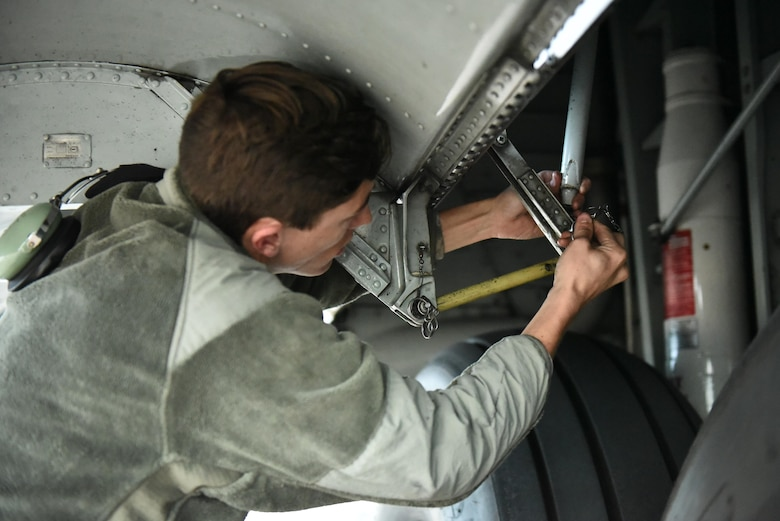 Senior Airman Drew Roberts works on landing gear of a 165th Airlift Wing C-130H3 Hercules during Operation Mangusta in Pisa, Italy. (U.S. Air National Guard photo by Senior Airman Brandon Patterson)