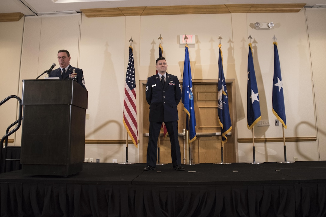 Ohio Command Chief Master Sgt. Tom Jones, recognizes Staff Sgt. Arsenio Hernandez for his national recognition as the Air Force Outstanding Cyber Operations Airman in the recent Air Force Information Dominance Award Program as members of the Ohio Air National Guard gather to honor this years nominees for Airman of the Year, Jan. 7, 2017. Each year outstanding airmen are selected to represent the best of categories separated by rank such as Commissioned Grade Officer (CGO), Senior Non-Commissioned Officer (SNCO), Non-Commissioned Officer (NCO) and Airman of the Year. Special categories include Honor Guard Member of the Year, Honor Guard Program Manager and First Sergeant of the year. (U.S. Air National Guard photo by Tech. Sgt. Joe Harwood\Released)
