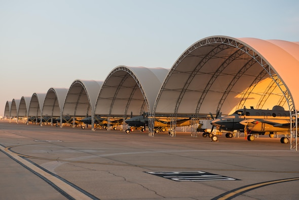MC-12W's from the 137th Special Operations Wing, Oklahoma City, are parked under eight new aircraft shelters for the Will Rogers Air National Guard Base flight line, January 31, 2016. The shelters provide protection for the aircraft and the Airmen and contractors who work on them. (U.S. Air National Guard photo by Senior Master Sgt. Andrew M. LaMoreaux)