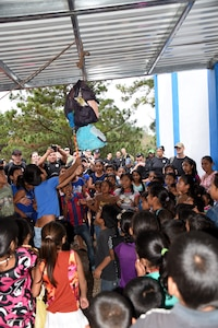 Children of the El Parasio village smack a piñata brought to them as part of Chapel Hike 71 Feb. 4. Members of Joint Task Force – Bravo participated in the hike just outside of Soto Cano Air Base to bring food and supplies to the underdeveloped village; and are also an opportunity to build partner relation capacity with a host nation. On most hikes, games and toys are brought along for the village kids to play with.