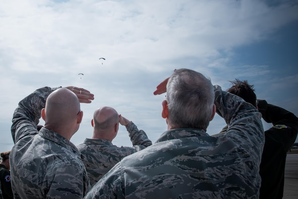 Col. Michael Manion, 403rd Wing commander, Col. Danny Davis, 81st Mission Support Group commander, Maj. Gen. Robert LaBrutta, 2nd Air Force commander, and Col. Mike Smith, 81st Training Wing vice commander, watch pararescue instructors from Keesler Air Force Base Mississippi completing a training jump Feb. 3. (U.S. Air Force photo/Staff Sgt. Heather Heiney)