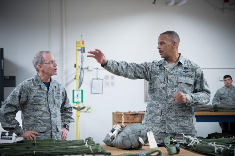 Master Sgt. Kenneth Holmes, 41st Aerial Port Squadron, explains how to pack a parachute to Maj. Gen. Robert LaBrutta, 2nd Air Force commander, during a 403rd Wing immersion tour Feb. 3 at Keesler Air Force Base, Mississippi. (U.S. Air Force photo/Staff Sgt. Heather Heiney)