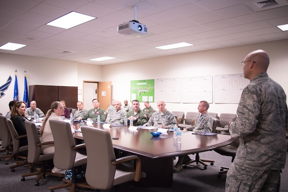 Col. Michael Manion, 403rd Wing commander, speaks to Maj. Gen. Robert LaBrutta, 2nd Air Force commander, and other attendees during a 403rd Wing immersion tour Feb. 3 at Keesler Air Force Base, Mississippi. (U.S. Air Force photo/Staff Sgt. Heather Heiney)