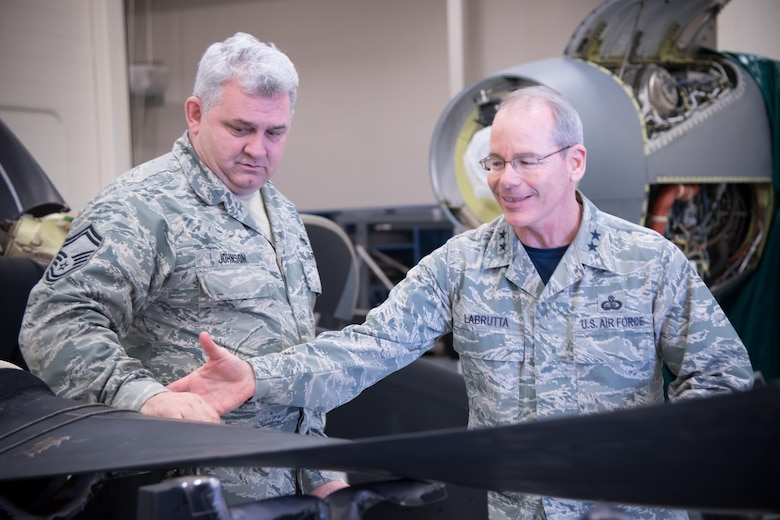 Senior Master Sgt. Eric Johnson explains the mission of the 403rd Maintenance Squadron's propulsion shop to Maj. Gen. Robert LaBrutta, 2nd Air Force commander, during his 403rd Wing immersion tour Feb. 3 at Keesler Air Force Base, Mississippi. (U.S. Air Force photo/Staff Sgt. Heather Heiney)