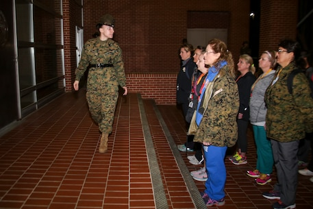 Staff Sergeant Jessica C. Navarro, a senior drill instructor, 4th Recruit Training Battalion, Recruit Training Regiment, instructs educators during Recruiting Stations (RS) Montgomery and Nashville Educators Workshop aboard Marine Corps Recruit Depot Parris Island, South Carolina, Feb. 8, 2017. The educators come from across Alabama, Mississippi, and Tennessee to experience the workshop. The Educators Workshop provides an opportunity to educators to have an inside look at Marine Corps training to better inform students in their local area. (U.S. Marine Corps photo by Lance Cpl. Jack A. E. Rigsby/Released)