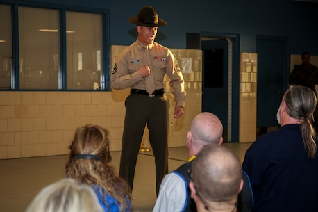 Staff Sergeant Bradley W. Hoffman, a senior drill instructor, 3rd Recruit Training Battalion, Recruit Training Regiment, speaks to educators during Recruiting Stations (RS) Montgomery and Nashville Educators Workshop aboard Marine Corps Recruit Depot Parris Island, South Carolina, Feb. 8, 2017. The educators come from across Alabama, Mississippi, and Tennessee to experience the workshop. The Educators Workshop provides an opportunity to educators to have an inside look at Marine Corps training to better inform students in their local area. (U.S. Marine Corps photo by Lance Cpl. Jack A. E. Rigsby/Released)