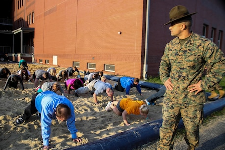 Staff Sergeant Gabriel Soto, a senior drill instructor, 3rd Recruit Training Battalion, Recruit Training Regiment, gives incentive training to educators during Recruiting Stations (RS) Montgomery and Nashville Educators Workshop aboard Marine Corps Recruit Depot Parris Island, South Carolina, Feb. 8, 2017. The educators come from across Alabama, Mississippi, and Tennessee to experience the workshop. The Educators Workshop provides an opportunity to educators to have an inside look at Marine Corps training to better inform students in their local area. (U.S. Marine Corps photo by Lance Cpl. Jack A. E. Rigsby/Released)