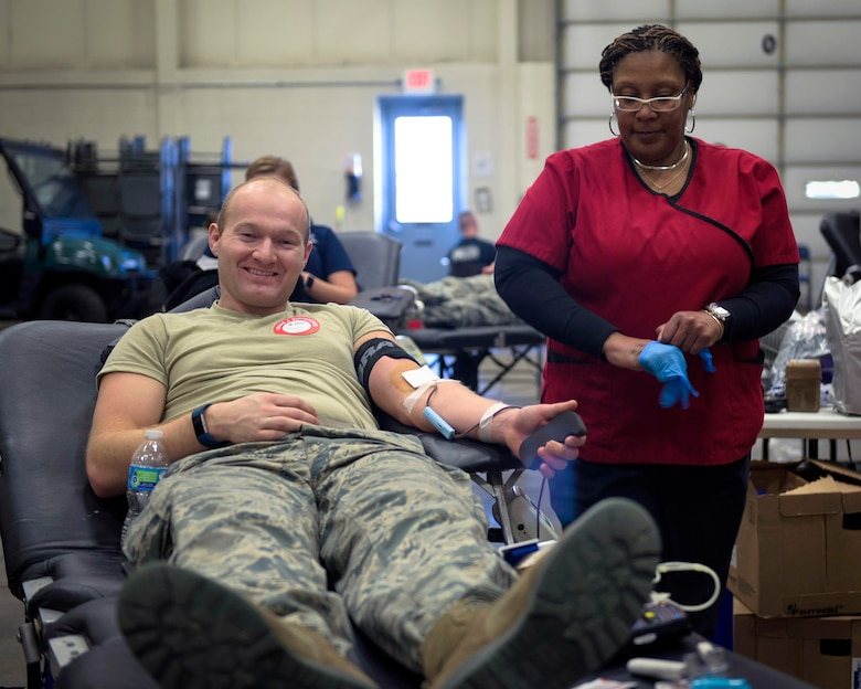 U.S. Air Force Staff Sgt. Ryan Porter, a fuels specialist with the 182nd Logistics Readiness Squadron, Illinois Air National Guard, donates blood in Peoria, Ill., Feb. 5, 2017. Porter and other Airmen helped exceed the installation's goal by 14%, which provided 57 pints of blood during a national emergency need appeal by the American Red Cross. (U.S. Air National Guard photo by Tech. Sgt. Lealan Buehrer)